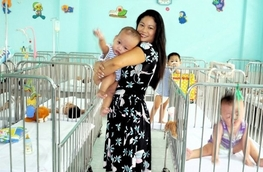 Kim in the ward at Go Vap Orphanage