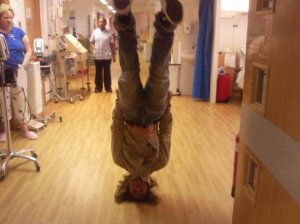 My good friend Chris cheering me up in hospital by standing on his head.  Don't try this at home.  Especially just after brain surgery.